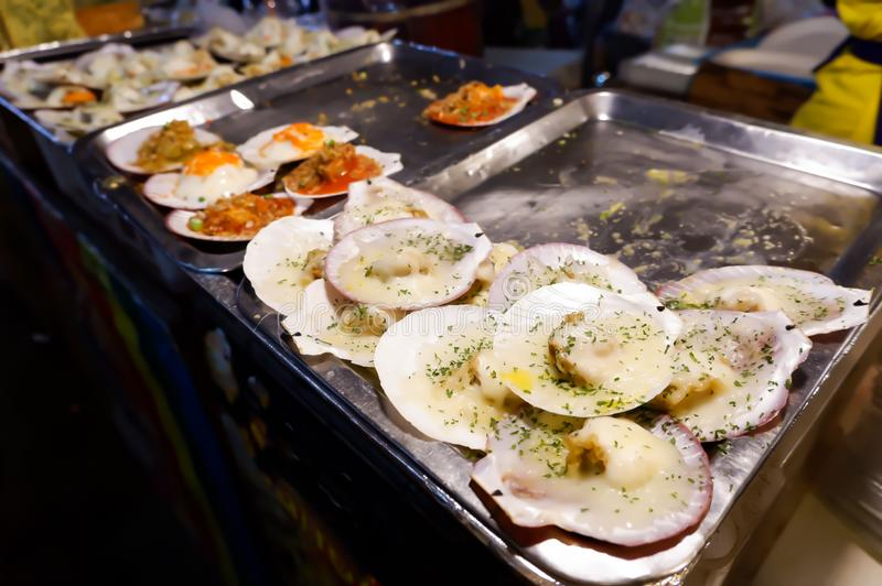 Scallops with cheese , Street food in Thailand stock photo