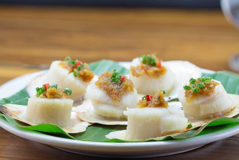 Scallops shells with thai basil pesto. On White dish royalty free stock photo