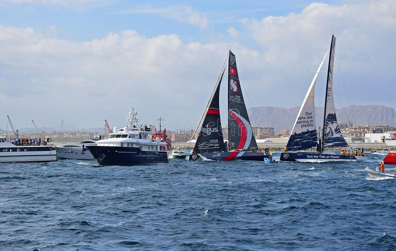 Scallywag And Clean Seas Squeezing Between The Spectator Boats Volvo Ocean Race Alicante 2017 stock images