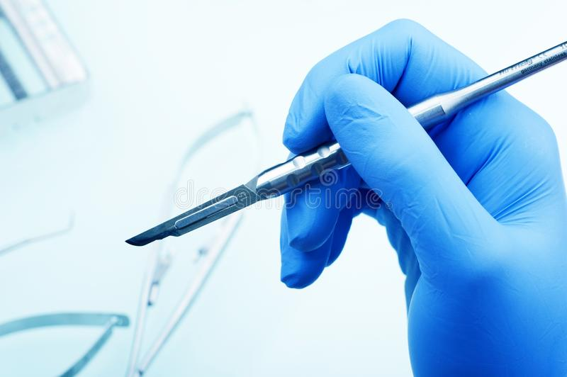 Download Scalpel in Hand stock image. Image of blue, hygiene, hand - 25955323