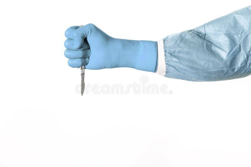 Scalpel in a surgeon fist stock image
