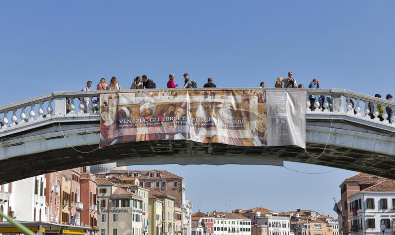 Scalzi bridge over Grand Canal in Venice, Italy. Unrecognized people on Scalzi bridge over Grand Canal. Venice is situated across a group of 117 small islands royalty free stock photos