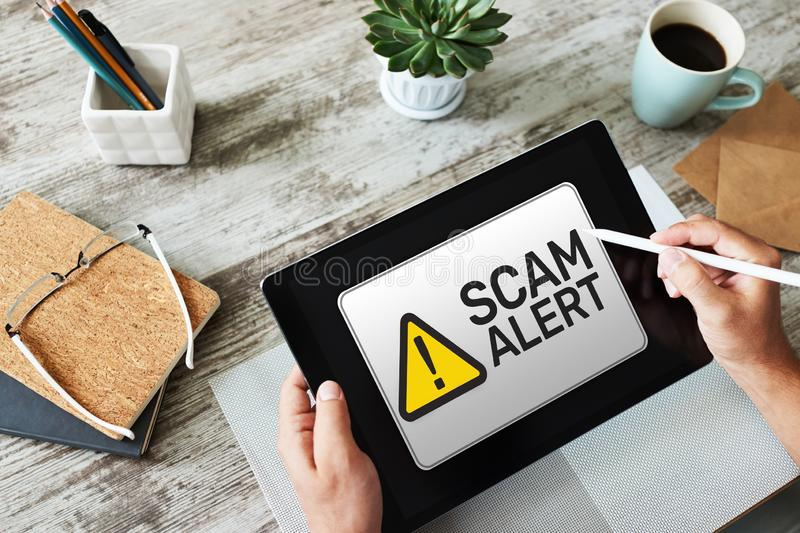 Scam alert detecting warning. Notification on device screen. stock images