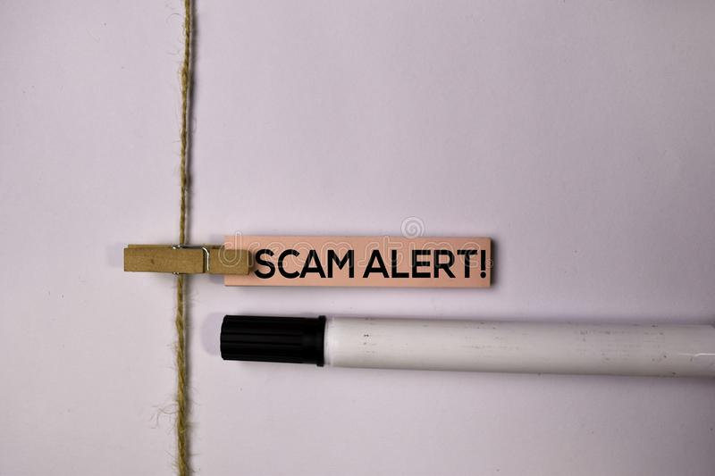 Scam Alert! on sticky notes isolated on white background stock photo