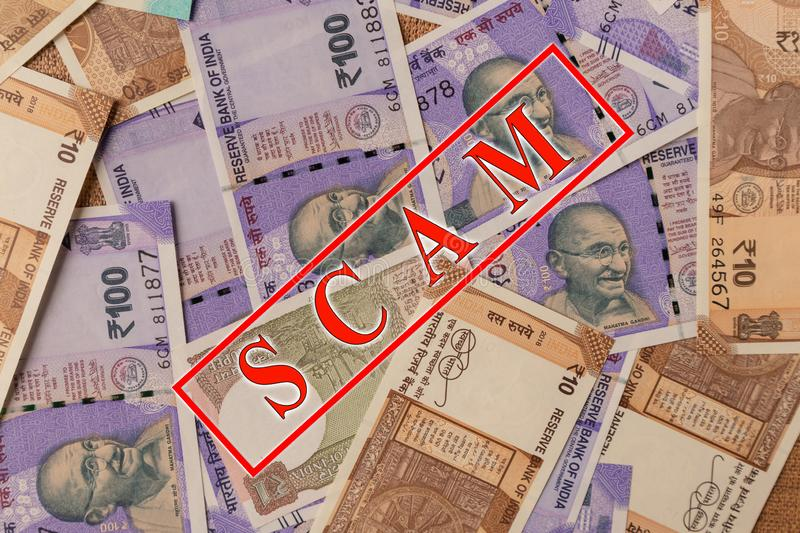 Scam and money concept, Scam in red alphabets printed on Indian currency Notes stock image