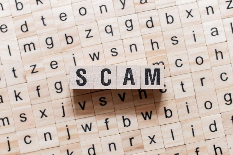 Scam word concept on cubes royalty free stock images