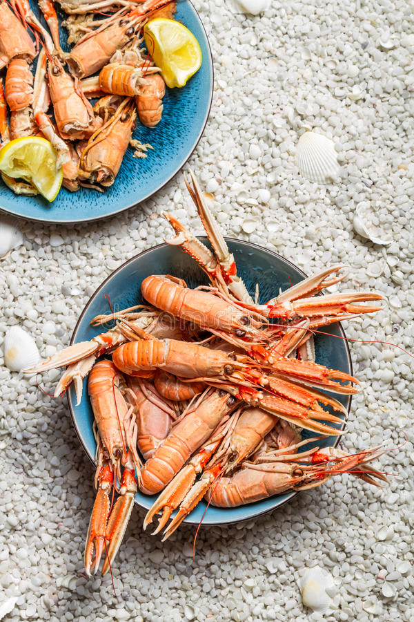 Scampi served with lemon stock images