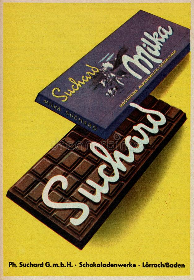 Very old vintage advertisement for Milka Chocolate in Germany during 1950s stock photos
