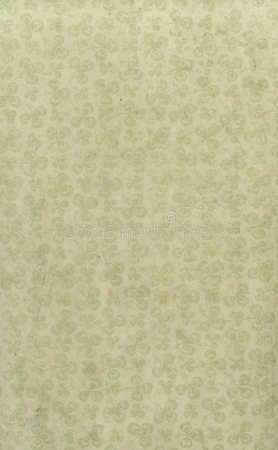 Scan the flyleaf of an old book, yellow-gray-brown, with dense and intricate floral pattern. stock photography