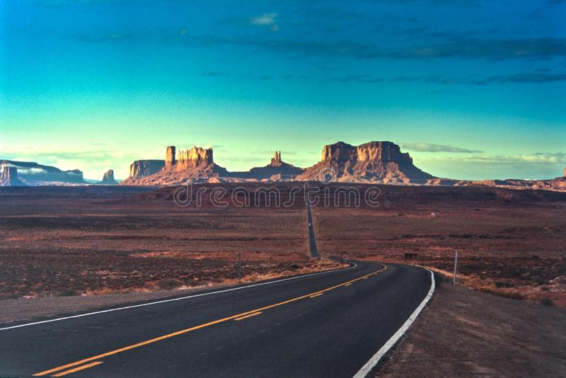 Scan of old slide depicting the famous road to Monument Valley i stock images