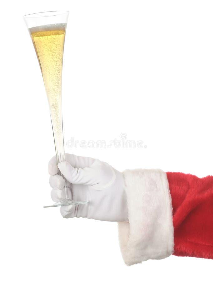 Scanalatura di Champagne della holding della Santa fotografia stock libera da diritti