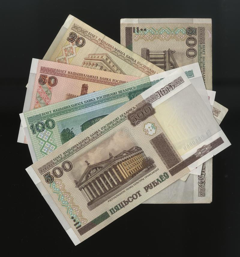 Scanarray five banknotes in denominations of 20, 50, 100, 500 Rubles from the Central Bank of Belarus. Located in the modern treatment of spread out like a fan royalty free stock photo