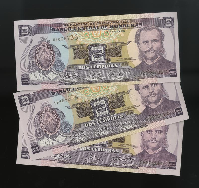 Scanarray three banknotes of 2, Lempira Central Bank of Honduras. Located in the modern treatment of spread out like a fan. The Lempira is the official currency royalty free stock photo