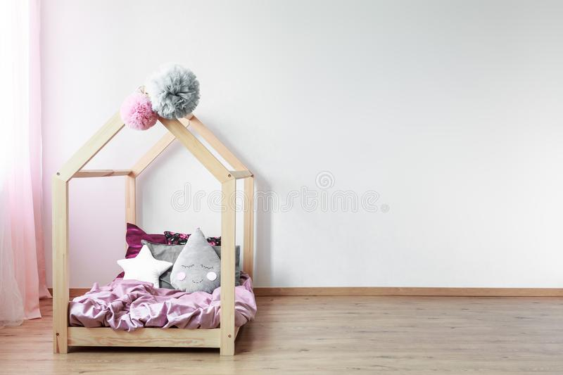 Scandi bed in girl`s bedroom royalty free stock photos