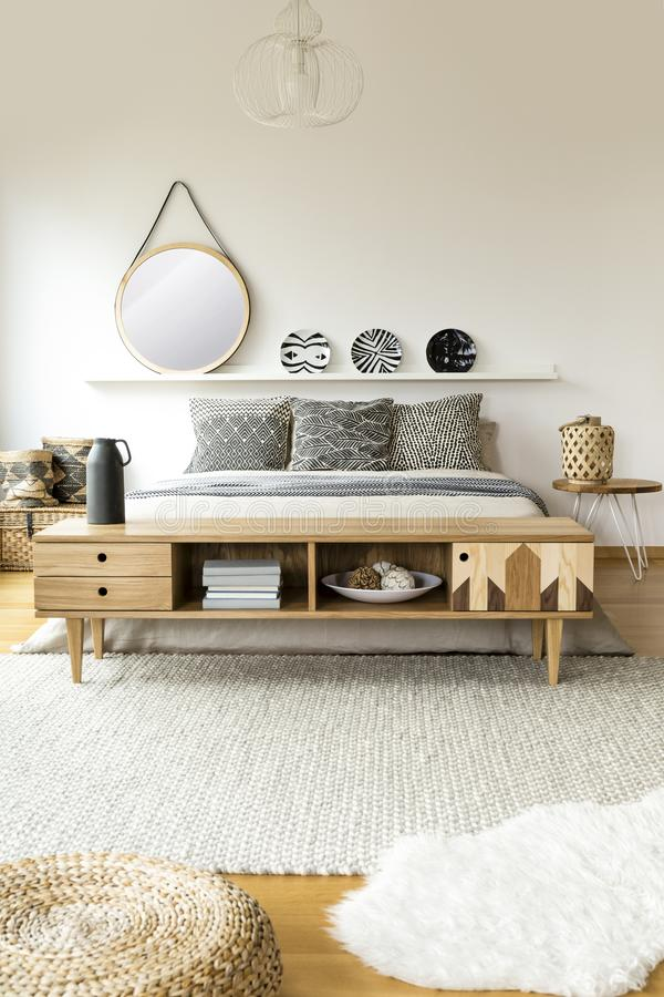 Scandi bedroom interior with mirror stock images