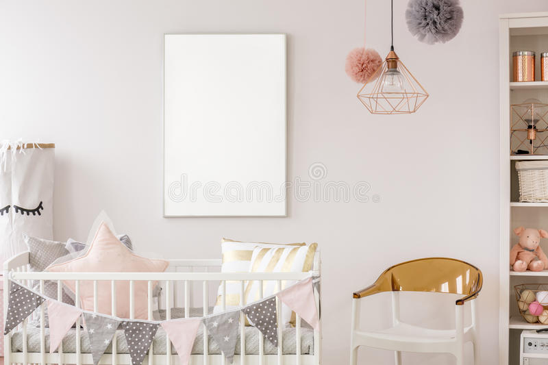 Scandinavian baby room with crib. Scandinavian baby room with white crib, chair, bookshelf, wall poster royalty free stock photo