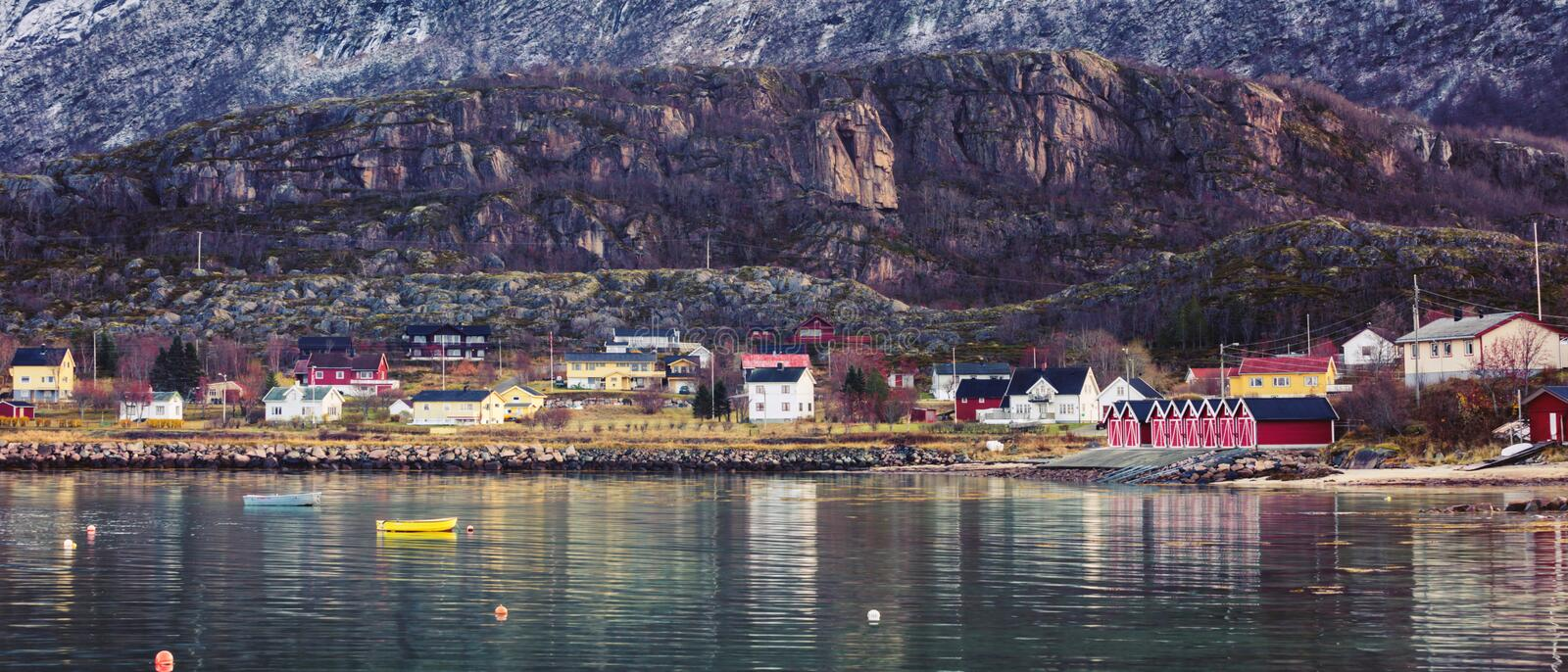Scandinavian fishing village at the foot of the mountain. stock photography