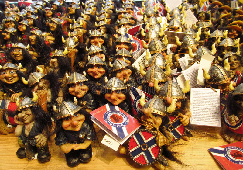 Scandinavian snouvenir ugly trolls army. Souvenir troll figure sold in the shop in Norway. Fairy tale mythological trolls, scandinavian myth and legends about royalty free stock photography