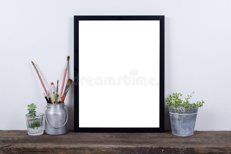 Scandinavian style empty photo frame mock up. Minimal home decor royalty free stock image