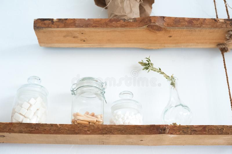 Scandinavian style kitchen decor details. Open wooden shelves, rustic rustic kitchen in bright colors and copy space stock photo