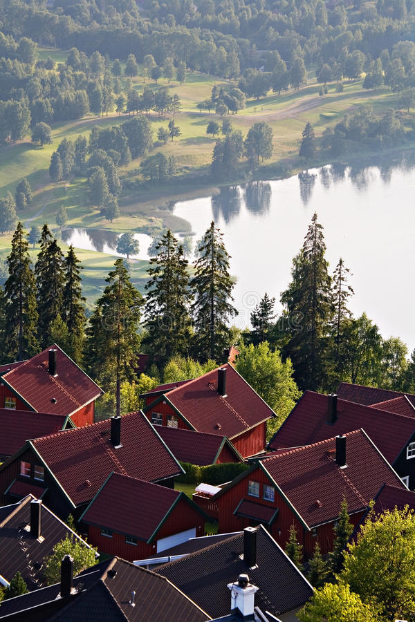 Scandinavian village with scenic lake and misty landscape stock photos