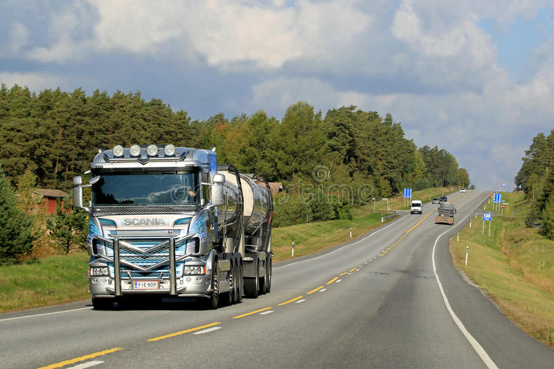 Scania R560 Tank Truck on the Road. RAISIO, FINLAND - SEPTEMBER 19, 2014: Decorated Scania R560 tank truck on the road. Scania R series for long haul was stock image