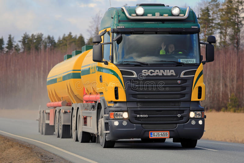 Scania V8 Tank Truck Trucking. SALO, FINLAND - APRIL 1, 2016: Colorful Scania R500 tank truck for bulk transport trucking along rural highway. Scania celebrates stock photos