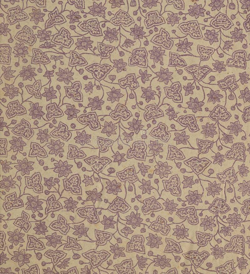 Scannen Sie das Vorsatzblatt eines alten Buches, gelb-grau-braun, mit dichtem und verwickeltem Blumenmuster lizenzfreie stockbilder