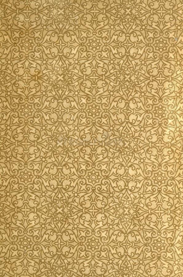 Scannen Sie das Vorsatzblatt eines alten Buches, gelb-grau-braun, mit dichtem und verwickeltem Blumenmuster lizenzfreie stockfotografie