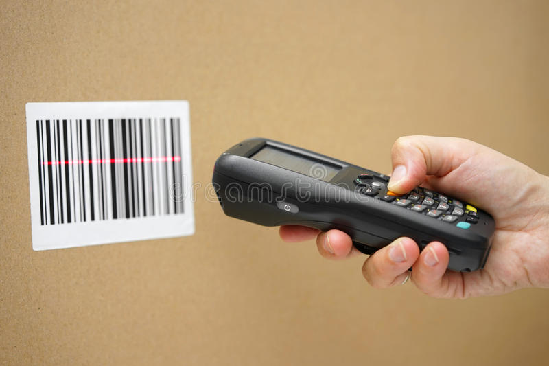 Scanning label. On the box with barcode scanner stock photography