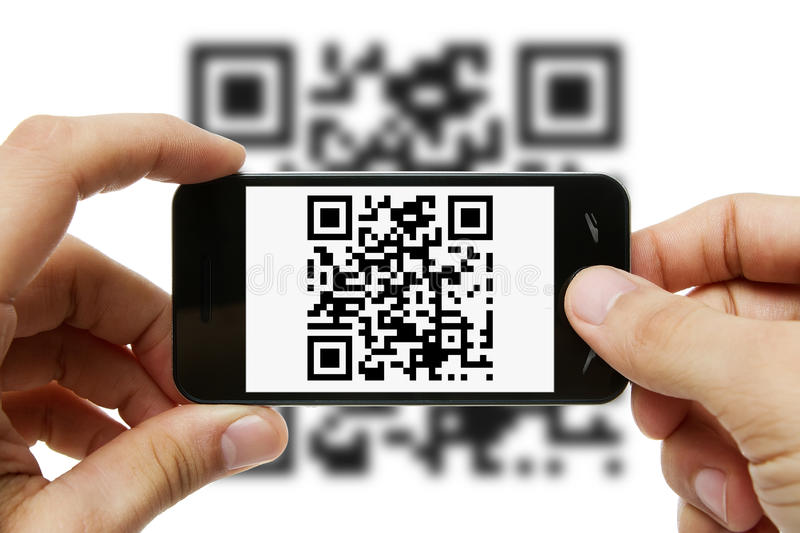 Scanning QR code. With mobile phone stock photography