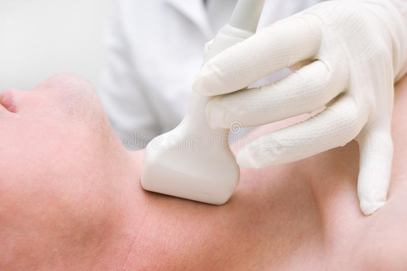 Scanning with ultrasound for thyroid research. Ultrasound system for thyroid diagnosis stock photo