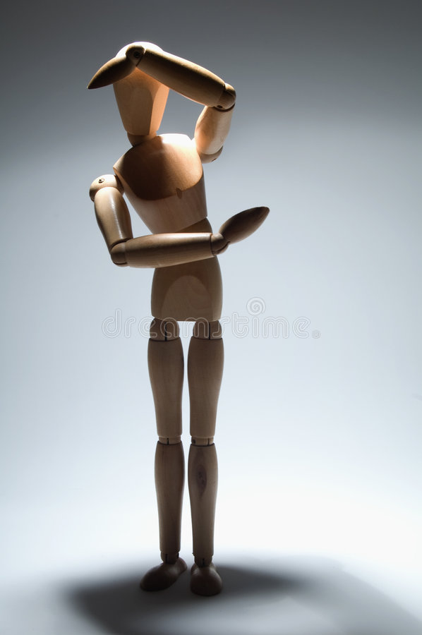 Scare metaphor. Scared and alone manikin, violence metaphor royalty free stock photo