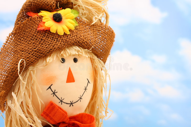 Scarecrow. Girl scarecrow with blue sky background for fall or autumn stock images