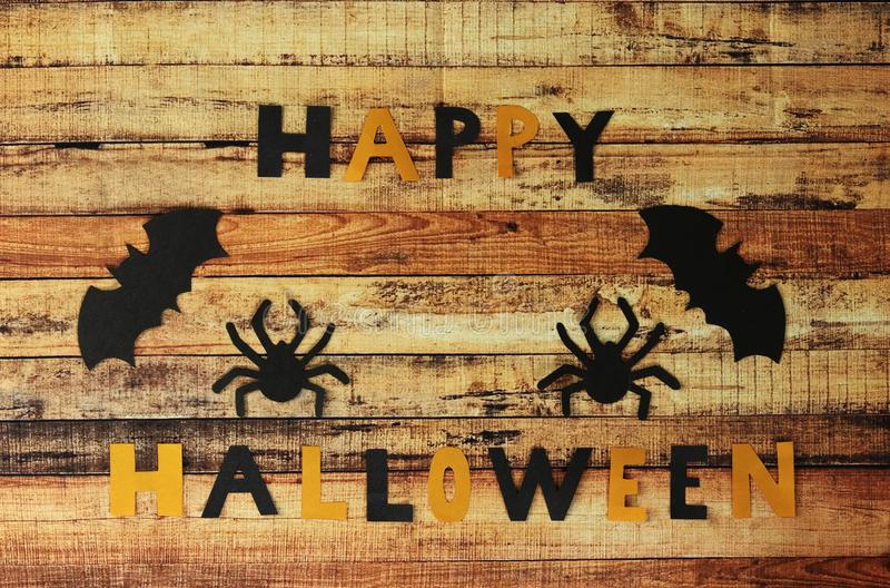 Scarecrow halloween background. Trick and treat. Wooden table happy holiday concept. Inscription of Happy Hallowen composed of. Orange and black letters made of stock photo