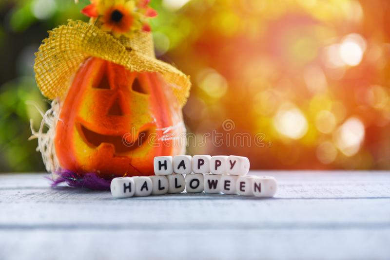 Scarecrow halloween background with word blocks happy halloween decorations and pumpkin jack o lantern funny spooky on wooden royalty free stock images