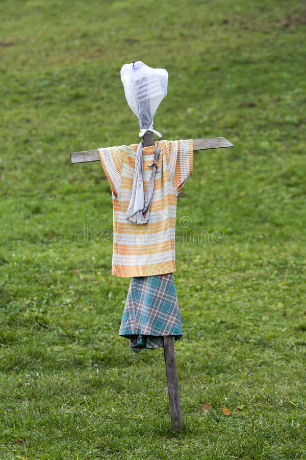 Scarecrow made of old clothes. In a field royalty free stock photography