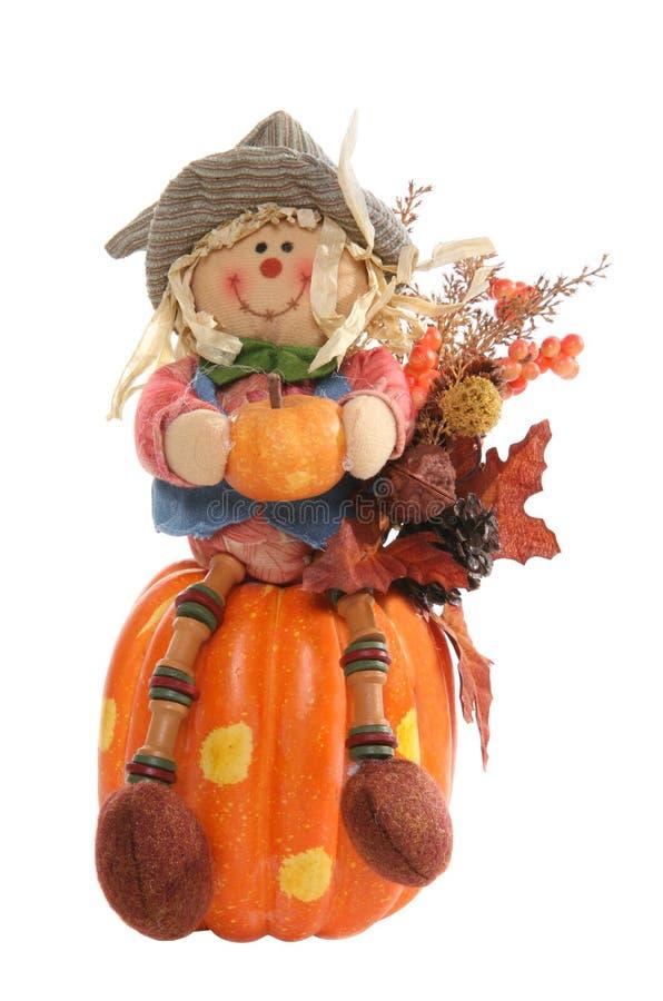 Scarecrow on Pumpkin stock photo