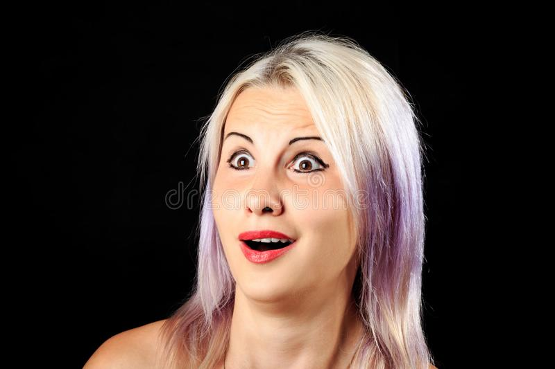 Scared使女性面孔惊奇 库存图片