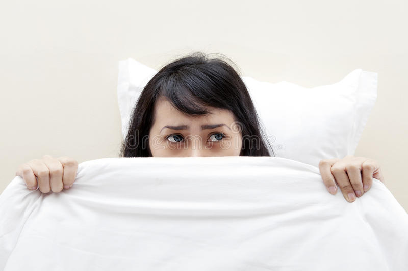Scared asian woman stock image