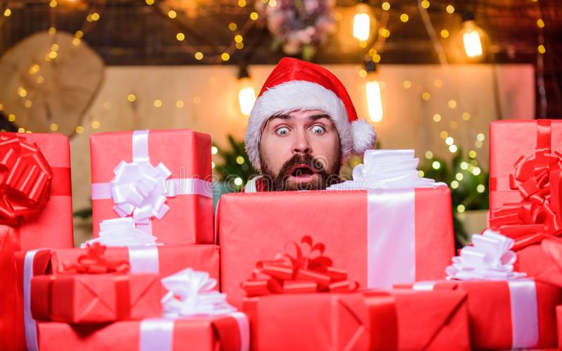 Scared bearded man. winter shopping sales. Cheerful elf. christmas gift delivery. Boxing day. hipster santa hat royalty free stock image