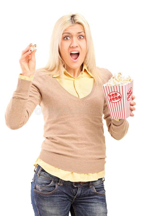 Scared Blond Woman Holding A Popcorn Box And Screaming Royalty Free Stock Photography