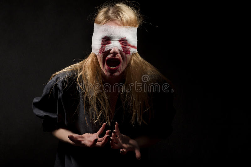 Scared bloody girl royalty free stock photos