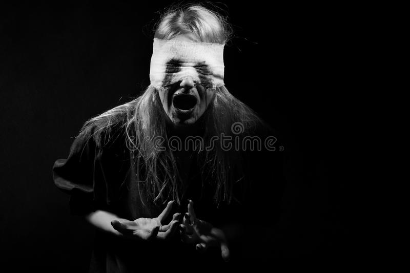 Scared bloody girl stock photography