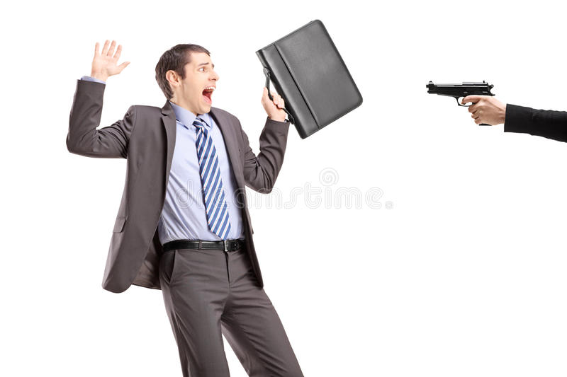 Download Scared Businessman From A Hand Holding A Gun Stock Photo - Image of concept, briefcase: 29888832