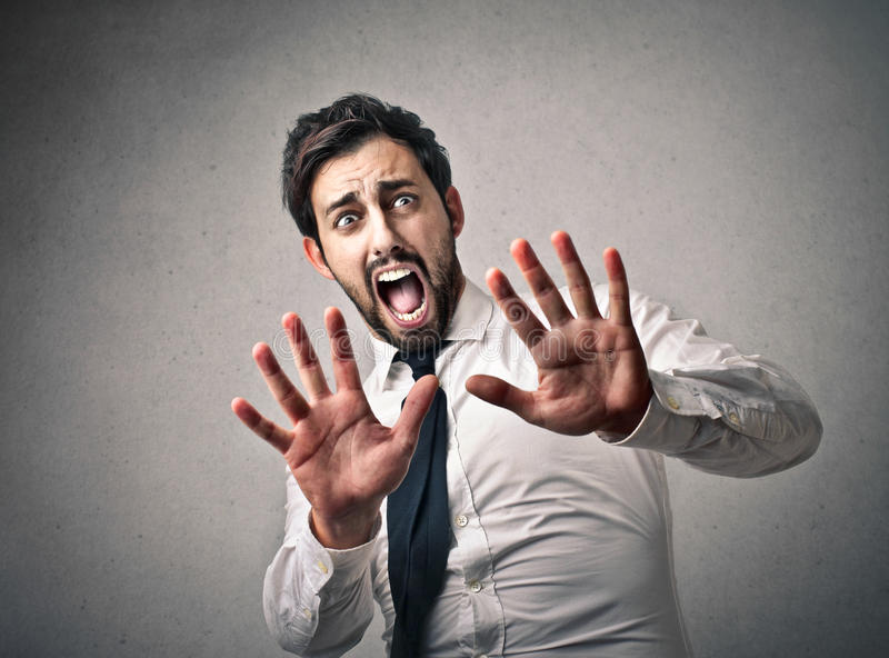 Scared businessman royalty free stock images