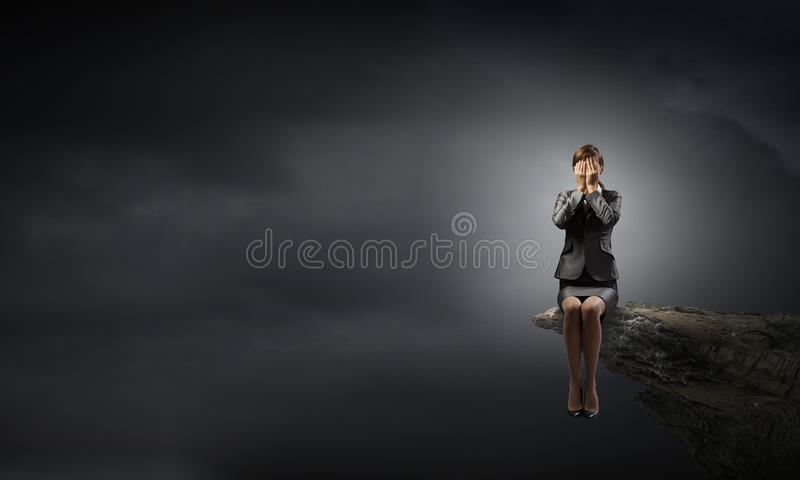 Scared businesswoman stock photography