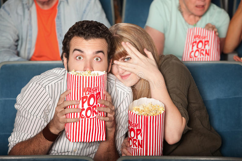 Scared Couple At Movies stock photo