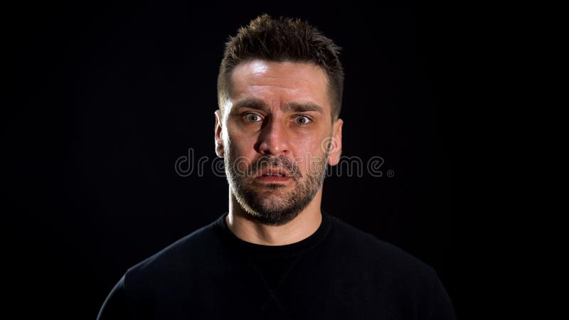 Scared crazy male looking camera, mental disorder, psychological trauma, shock. Stock photo royalty free stock image