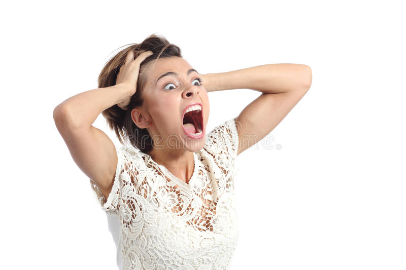 Scared crazy woman crying with hands on head royalty free stock images